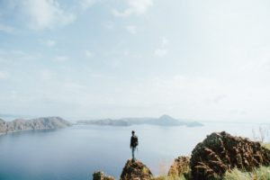 Photo of person at mountain top of Padar Island Summit